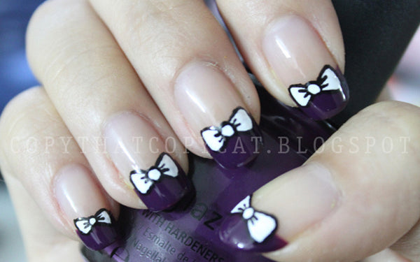purple bow nail art design