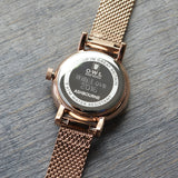 Rose gold mesh watch with case back engraving