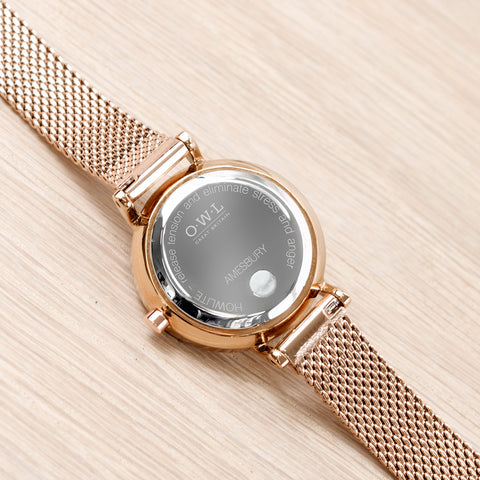 Stone set into the back of the watch on a rose gold mesh