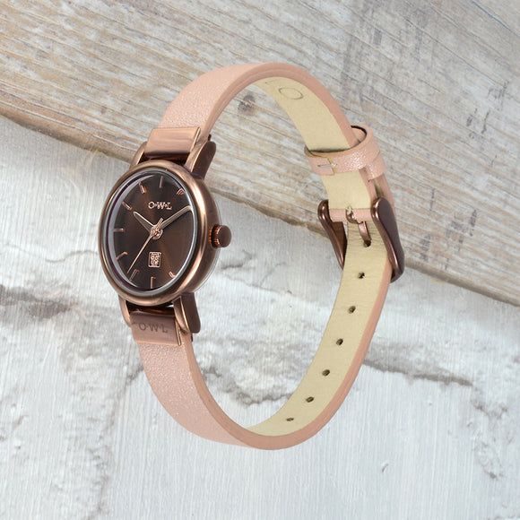 warm brown ladies watch offset with rose gold detail is finished on a soft nude pink leather strap