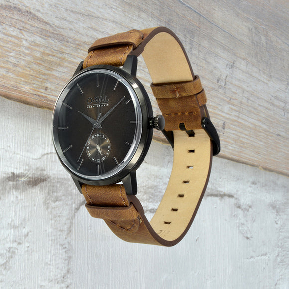 black case mens watch on vintage style leather strap