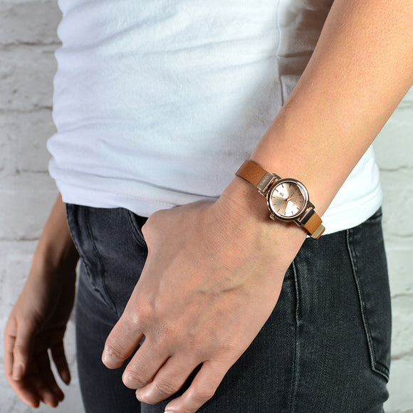 Ladies watch on metaillic snake leather with a rose gold case