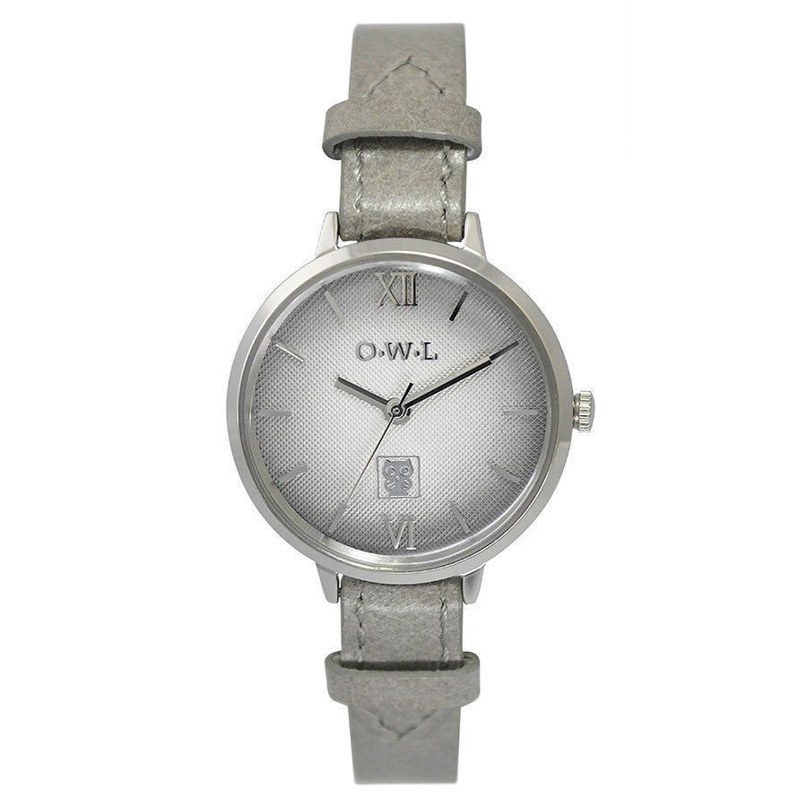 Soft graduated dial on a vintage inspired silver case with a grey leather strap