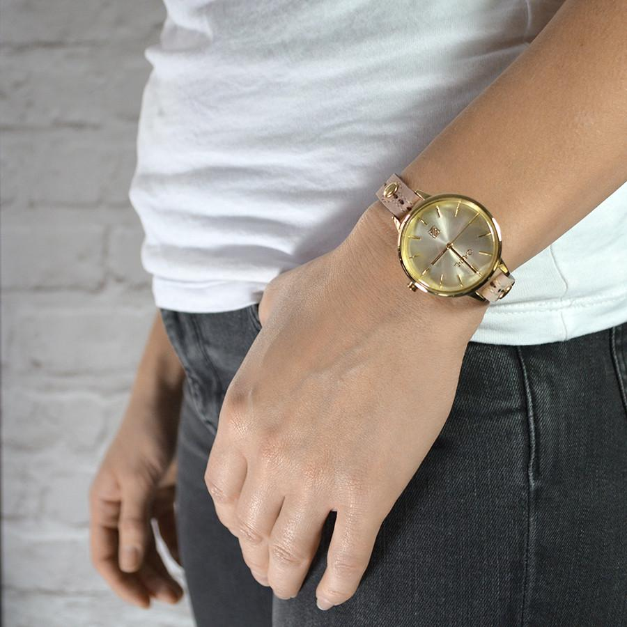 Clean oped watch dial in gold, inspired by British Design