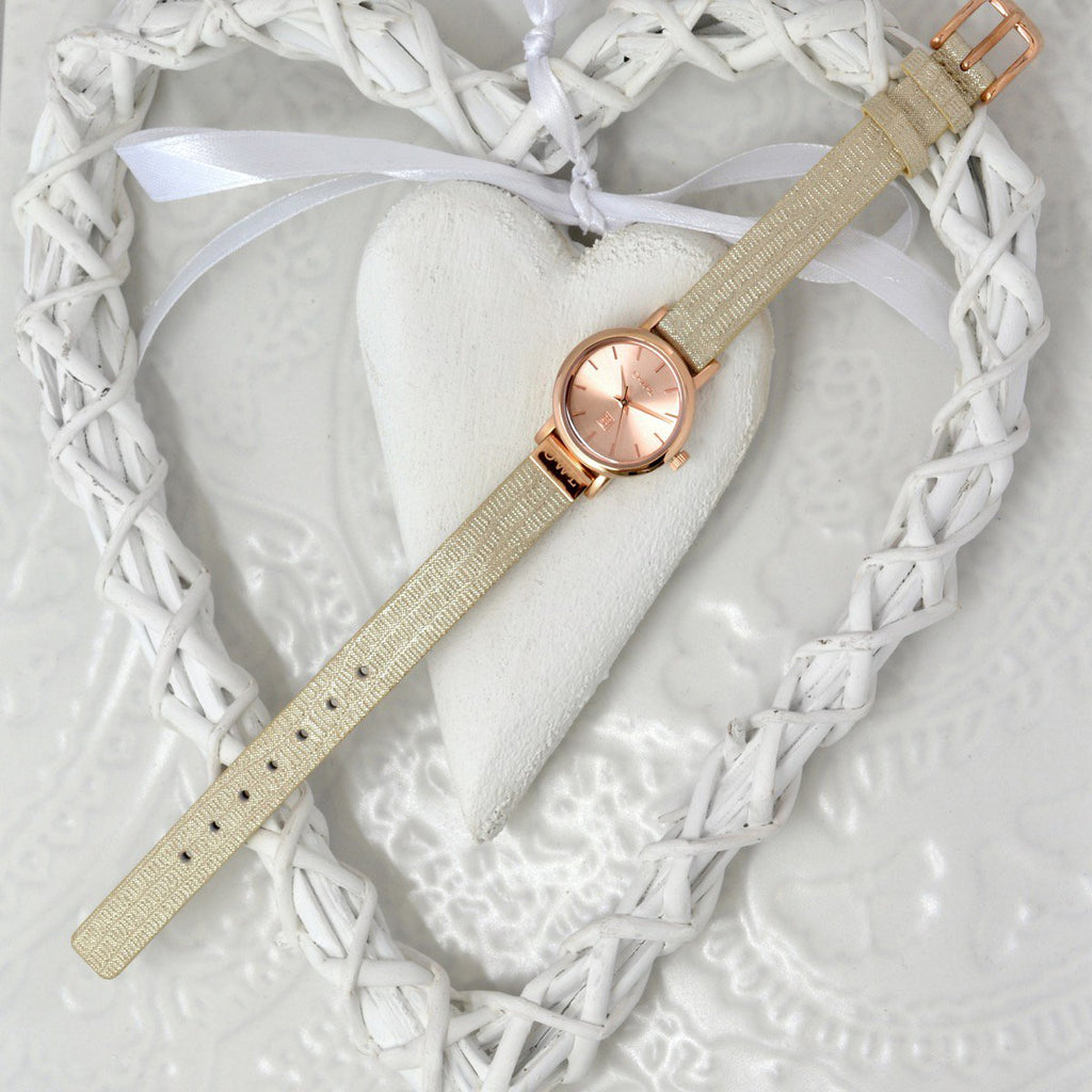 Rose gold snake watch on a white heart