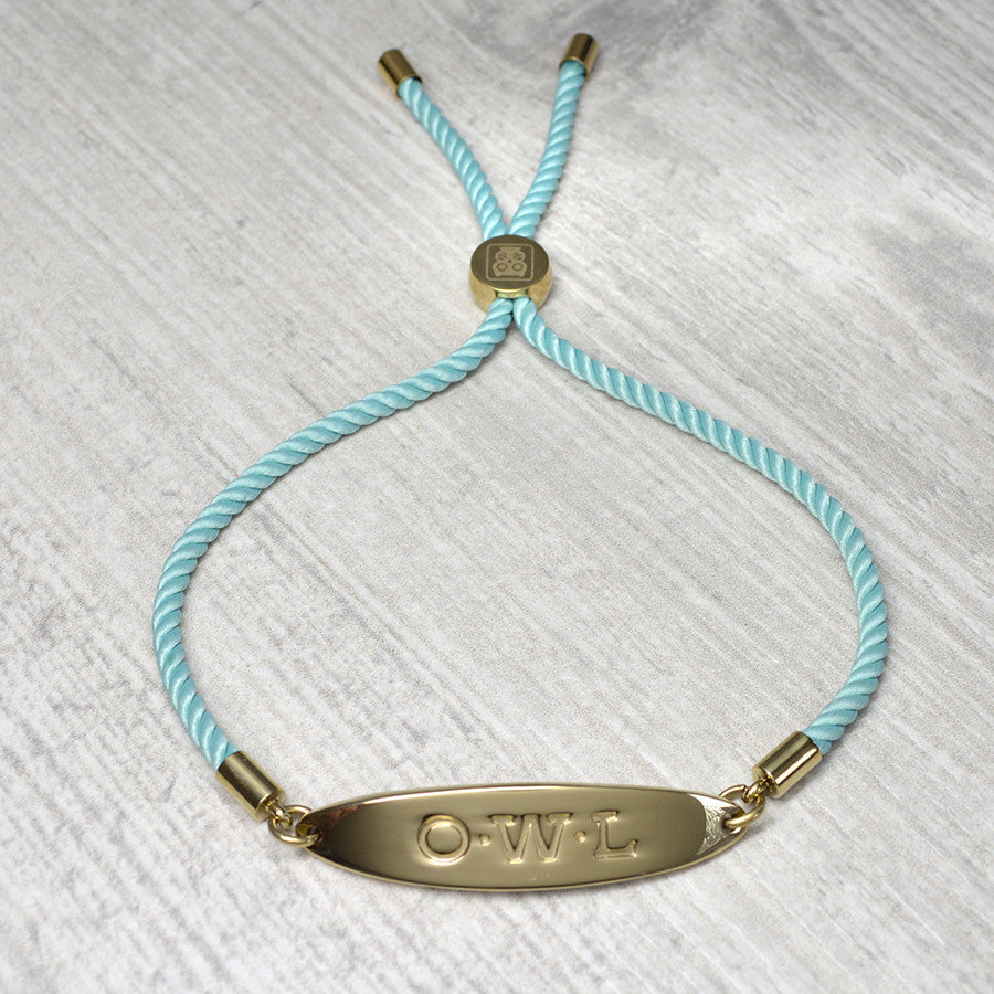 Metal friendship bracelet in gold with a jade cord