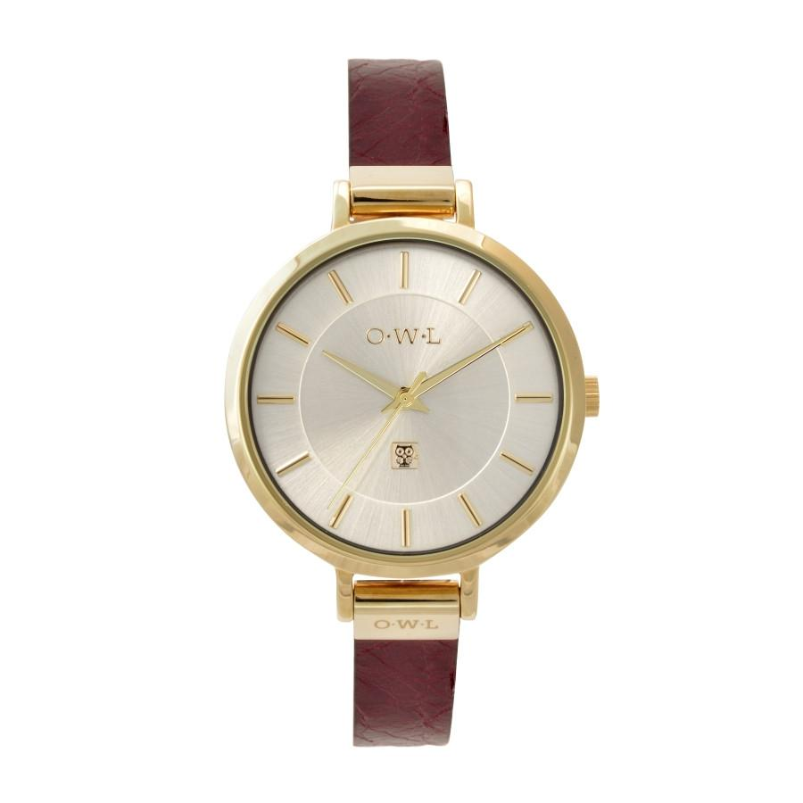 pale gold ladies watch on a vintage style red leather strap