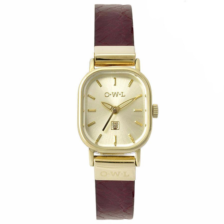 gold vintage style ladies watch on a red strap
