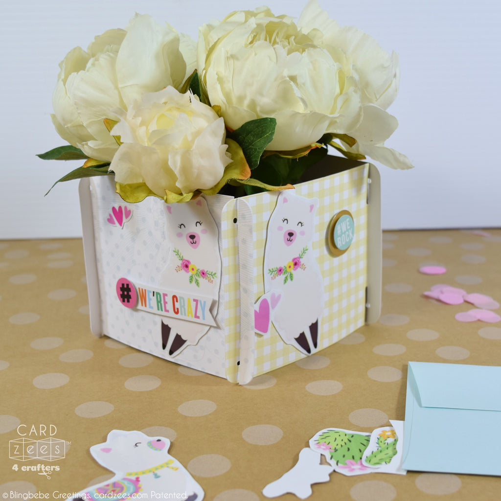 Use CARDzees as a wrap around a small vase of flowers