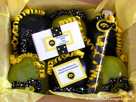 Party in a box with balloons filled with money from Amy Miller Designs