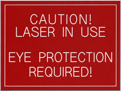 CAUTION LASER IN USE...