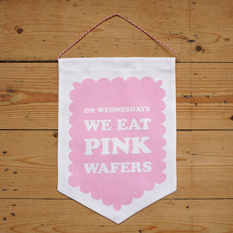 On Wednesdays We Eat Pink Wafers Printed Fabric Banner