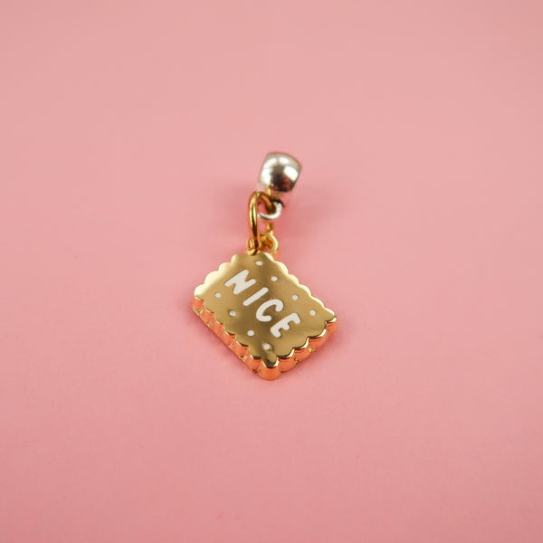 Nice biscuit gold charm by Nikki McWilliams