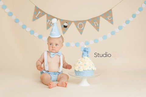 Baby boy in blue cake smash outfit