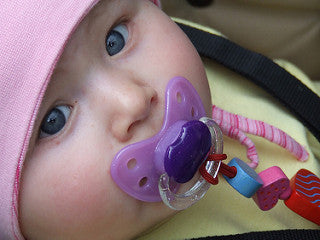 Baby with Dummy Clip.