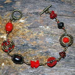 red and antique gold bush bead bracelet