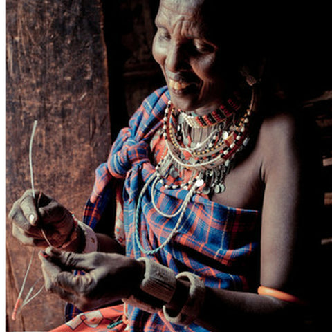 maasai artisan making bush bead jewelry