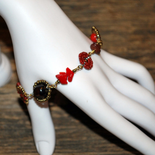 bush bead red antique gold bracelet on model hand