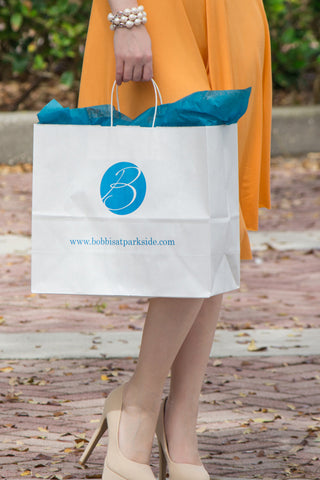 A very stylish girl and her shopping bag in Historic Cocoa Village