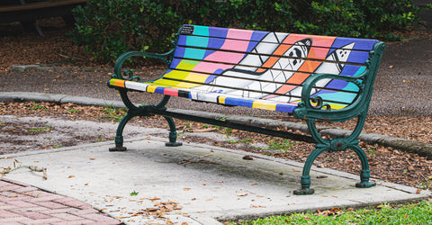 park bench with rocket painted illustrations from space coast florida