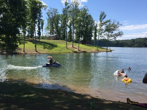 Michelle David & Friends Jet Skiing On A Rural River