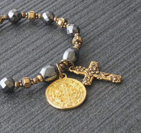 Christian St Benedict stretch bracelet, hematite gold medal cross
