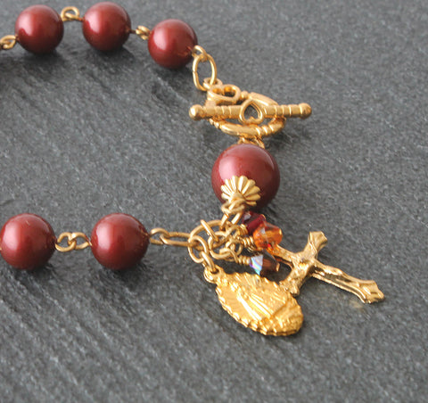 Swarovski pearl rosary bracelet, burgundy and gold, Infant of prague charm