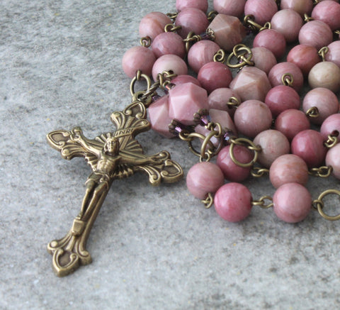 Womans rosary, pink beads, bronze crucifix traditional layout