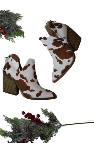 Cow Print Booties on Brown