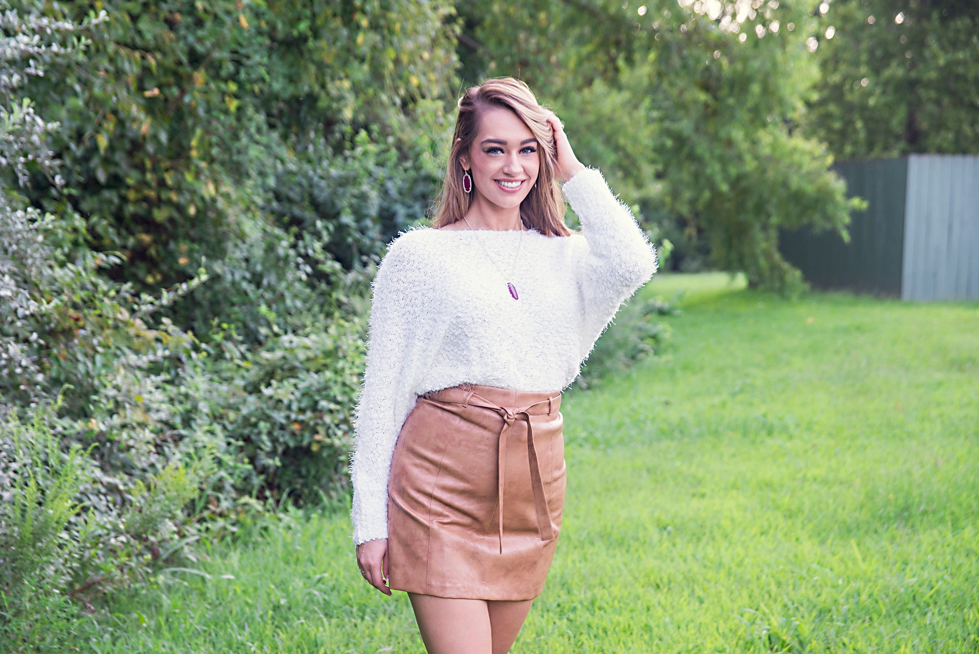 trendy faux brown leather skirt and cozy cream sweater at Eccentrics Boutique. Online women's lifestyle clothing boutique.
