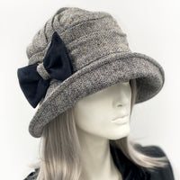 Alice wide front brim hat in herringbone wool with bow brooch  side front view