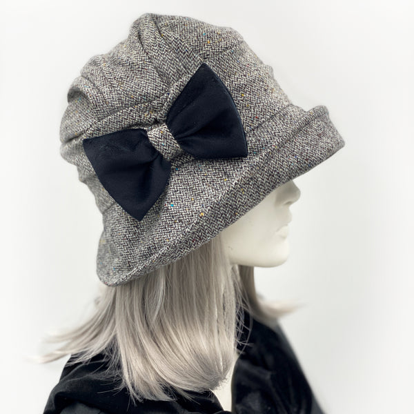Alice wide front brim hat in herringbone wool with bow brooch