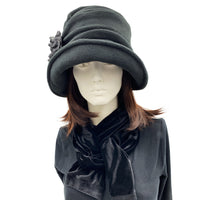 Alice wide front brim black fleece cloche with large  flower detail with Ostrich feather front view
