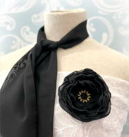 Black chiffon scarf with rose brooch