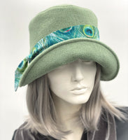 Eleanor cloche hat in fern green wool with Peacock hat band front view