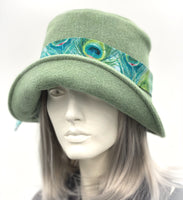 Eleanor cloche hat in fern green wool with Peacock hat band side front view