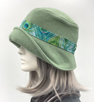 Eleanor cloche hat in fern green wool with Peacock hat band side view