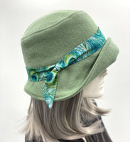 Eleanor cloche hat in fern green wool with Peacock hat band