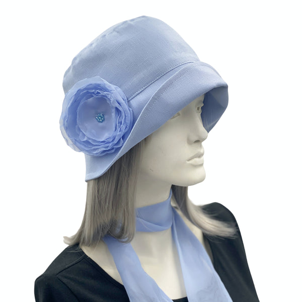 Eleanor narrow brim Pale blue linen with chiffon rose brooch Boston Millinery  side view