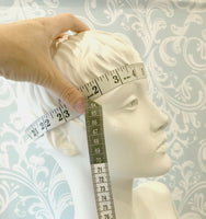 showing how to measure head size