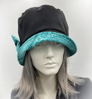 showerproof bucket hat in black with turquoise contrast front view
