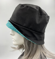 showerproof bucket hat in black with turquoise contrast side view