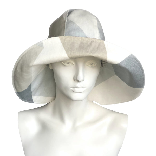 Womens wide brim derby hat in neutral and blue patchwork linen