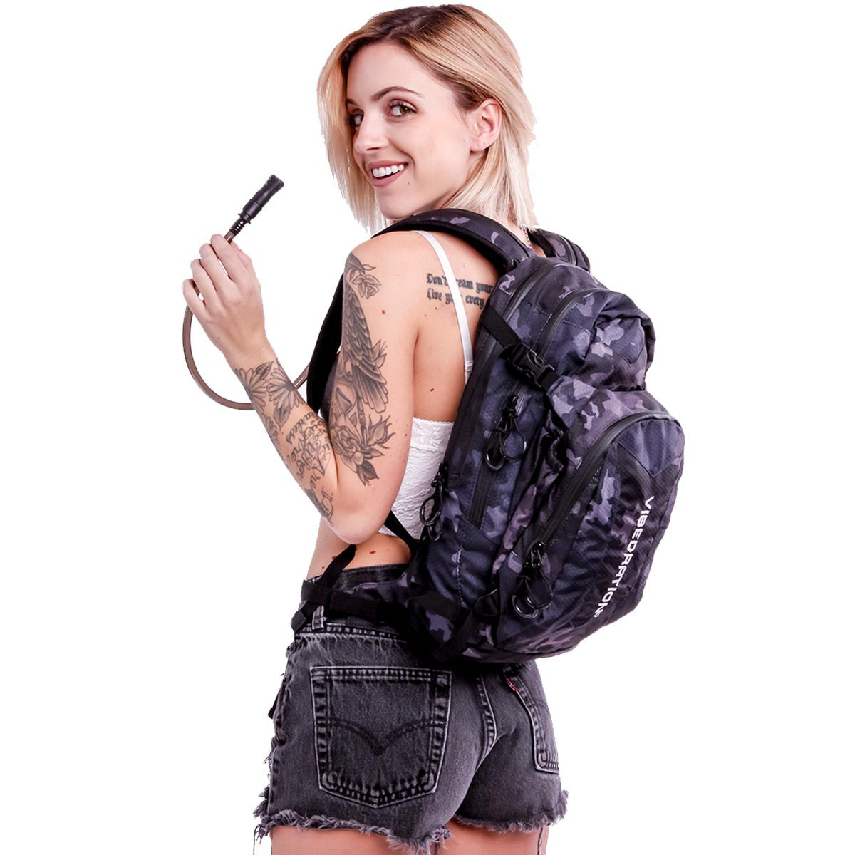 Female wearing Camo Black hydration pack