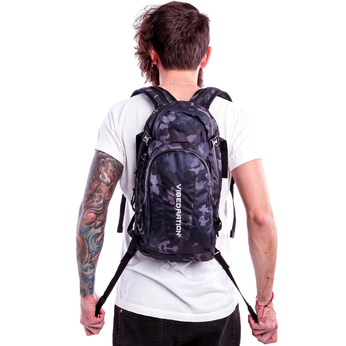 Male wearing Camo Black hydration pack