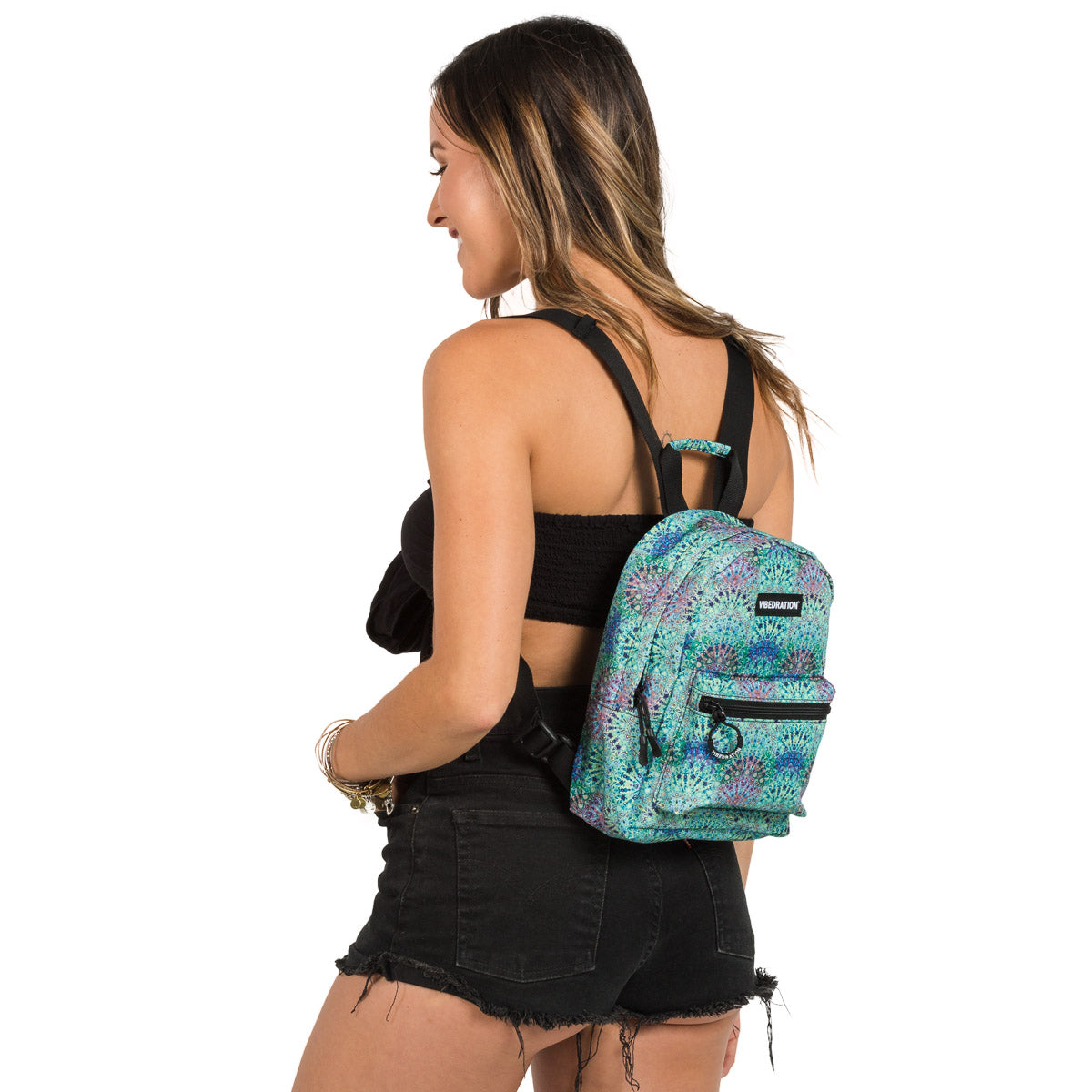 Female wearing Bohemian Printed Mini Backpack with Hydration Bladder