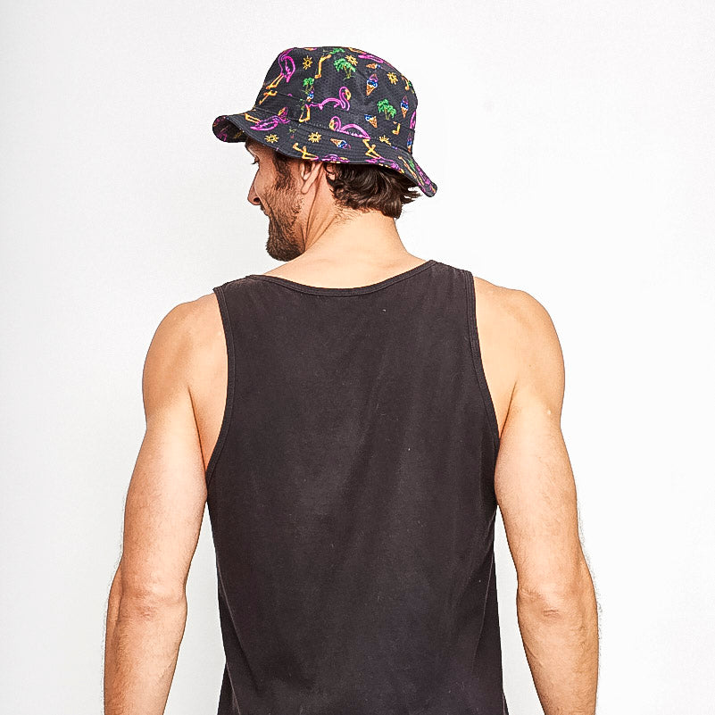 Back view of male wearing black rave bucket hat with neon flamingos