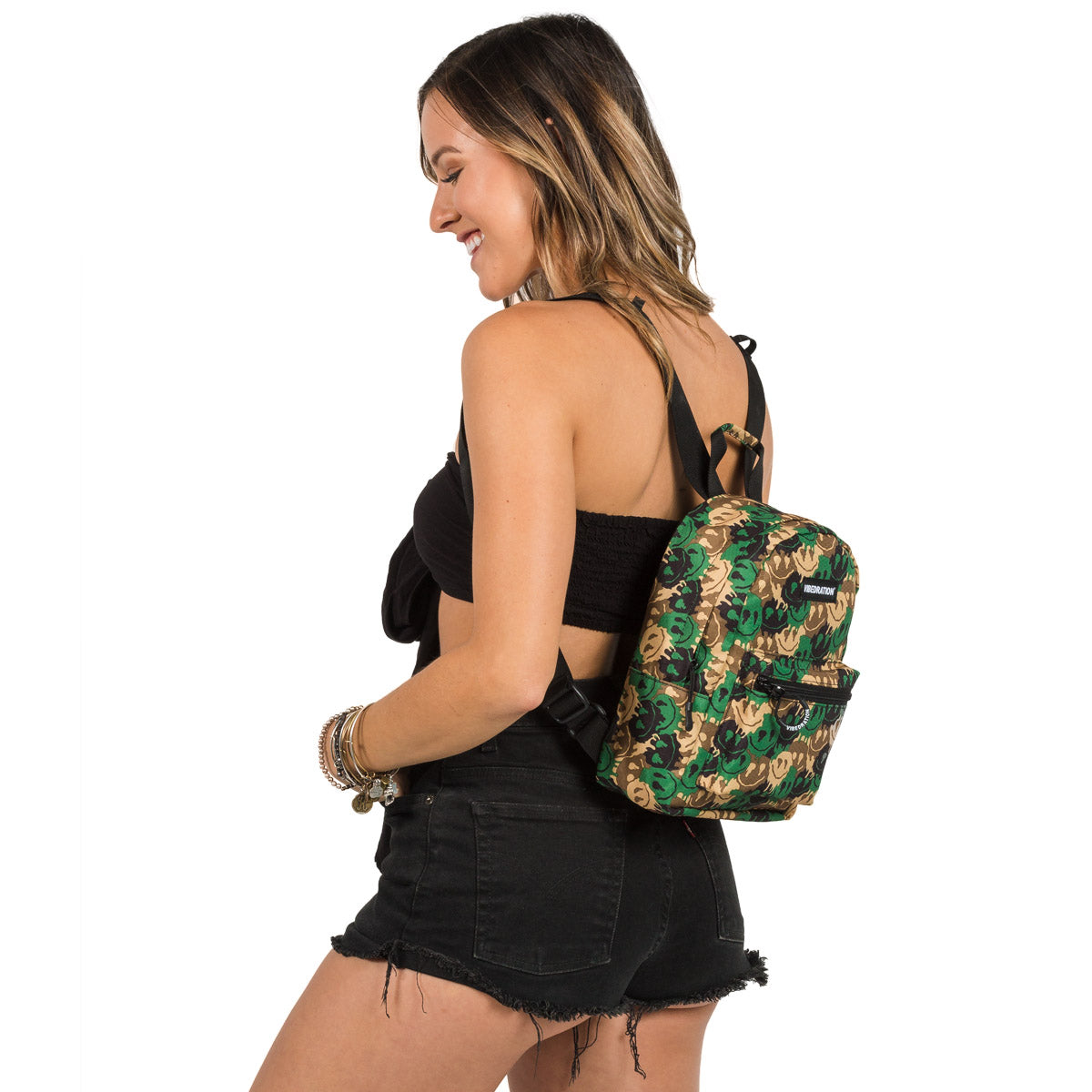 Female wearing Camo Mini Backpack