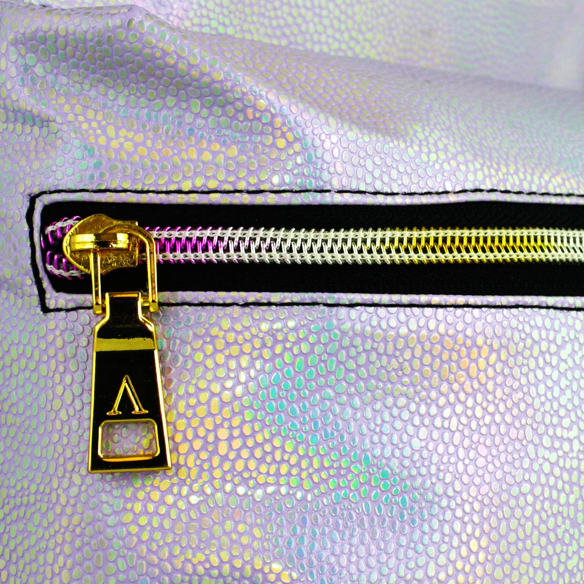 Detail of gold zipper on lavender leather designer hydration pack.
