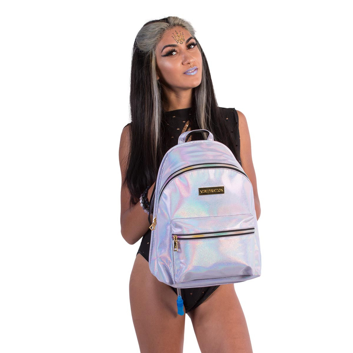 Female holding lavender leather designer hydration pack with rainbow zippers.